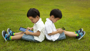 Two kids using tablet